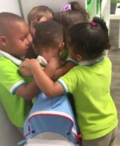 Students hug classmate after Hurricane Dorian