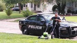 Police-officer-mow-lawn