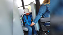 bus-driver-comforts-boy-first-day-school
