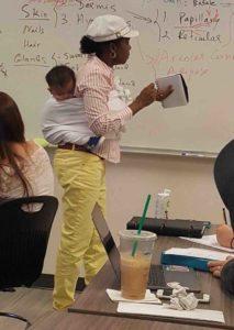 professor-cuddles-students-baby