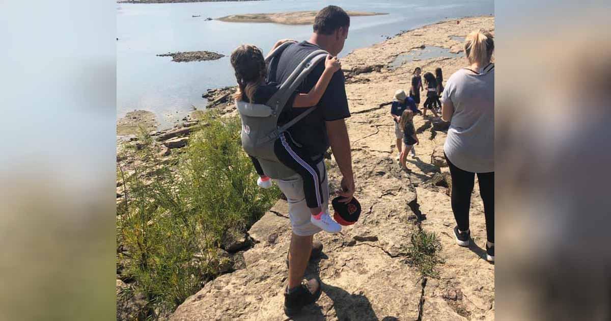 teacher carries student with spina bifida