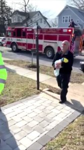 Firefighters deliver couple's adopted son
