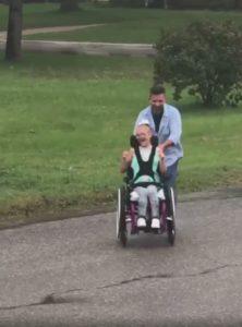 dad-pushes-wheelchair-bound-daughter
