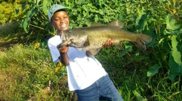 boy-catches-first-fish-main