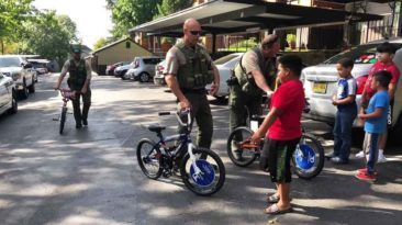 Clackamas-County-officers-buy-kids-bikes