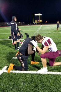 sherman-football-player-prays-with-opponent-2