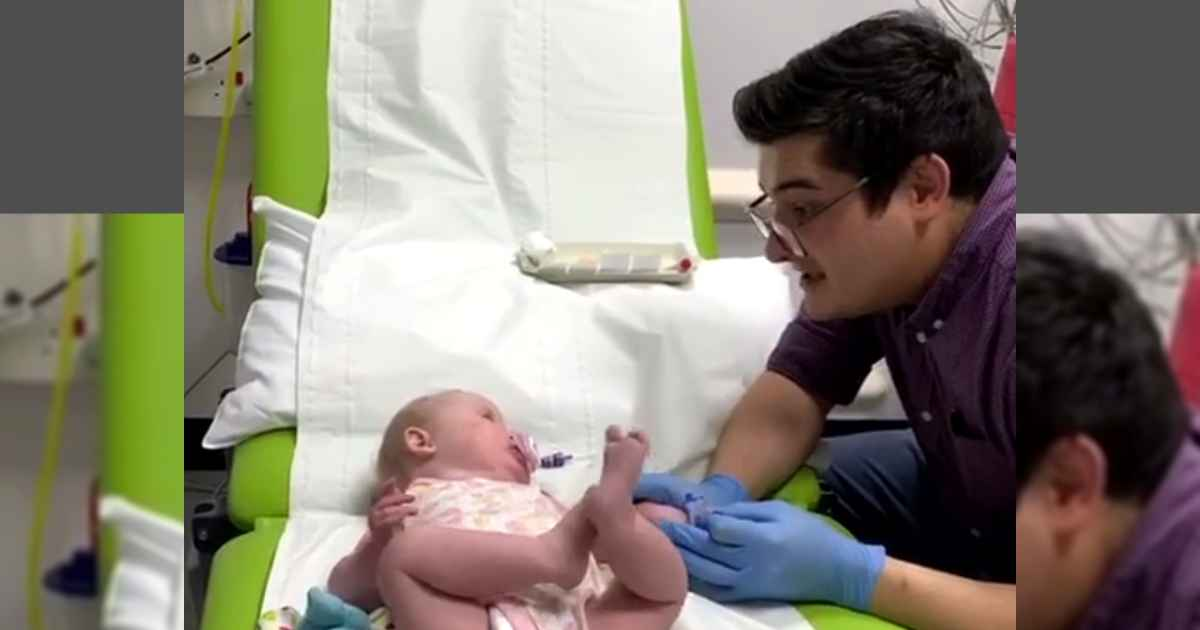 doctor-singing-to-baby-patient