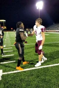 sherman-football-player-prays-with-opponent
