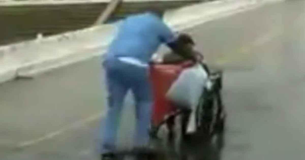 man-push-wheelchair-rain