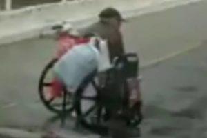 man-push-wheelchair-rain-2