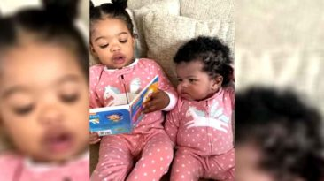 girl-reads-to-little-sister