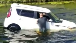 man-saves-woman-from-sinking-car