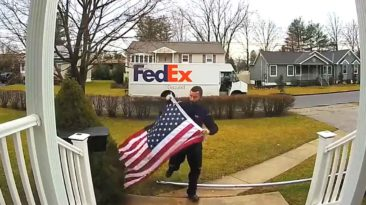 fedex-driver-folds-flag