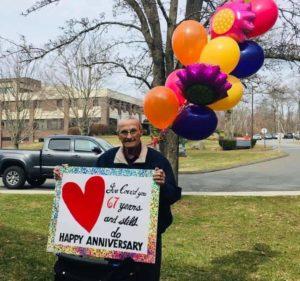man-stands-outside-nursing-home-wedding-anniversary