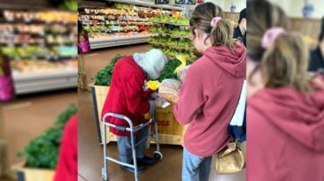 girl-helps-scared-elderly-couple-shop