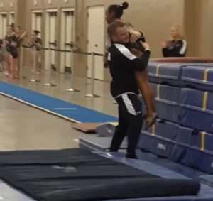 Coach-Catches-9-Year-Old-Gymnast
