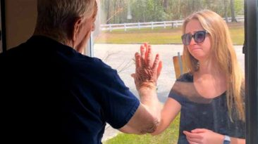 woman-shows-off-engagement-ring-to-quarantined-grandfather