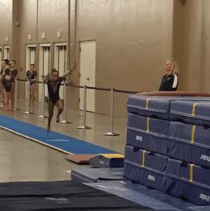 coach-catches-gymnast