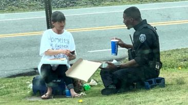 officer-feeds-homeless-woman