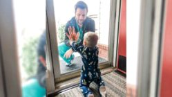 doctor-sees-son-through-glass-door