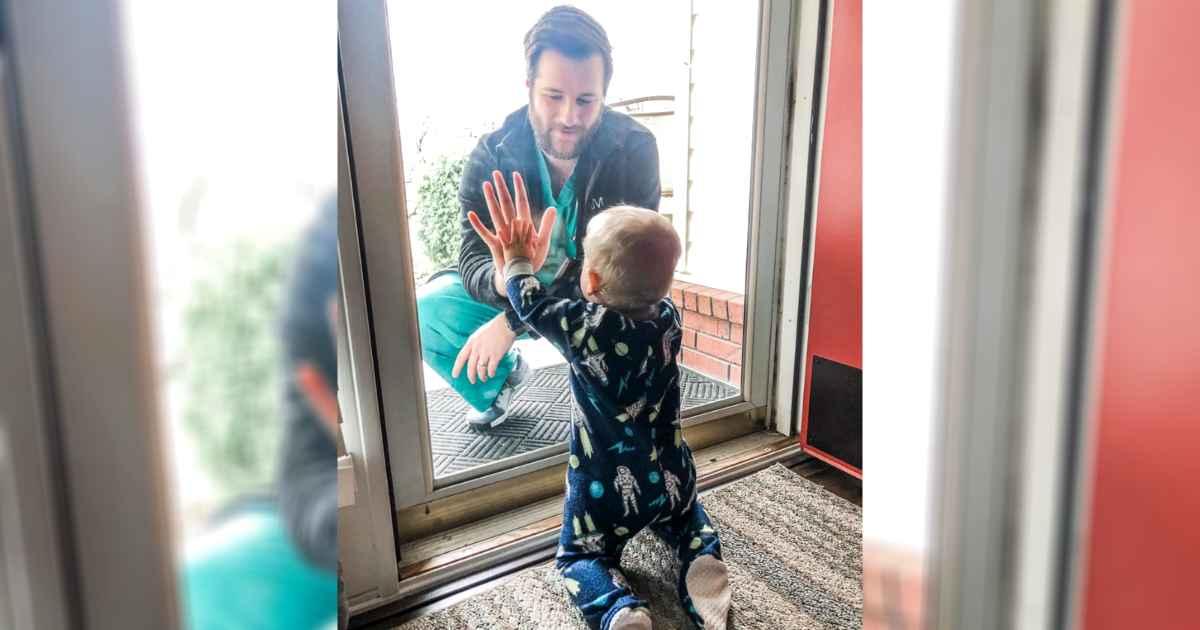 doctor-sees-son-through-glass-door