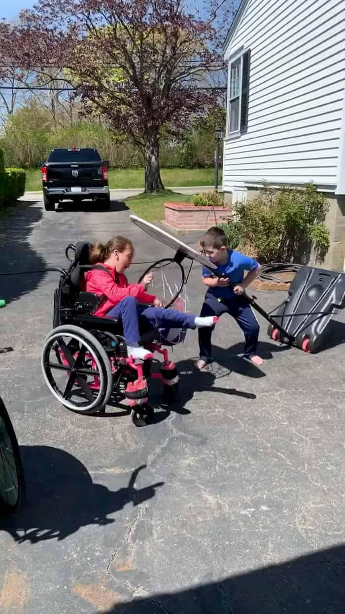boy-help-wheelchair-bound-sister-score-basket-3