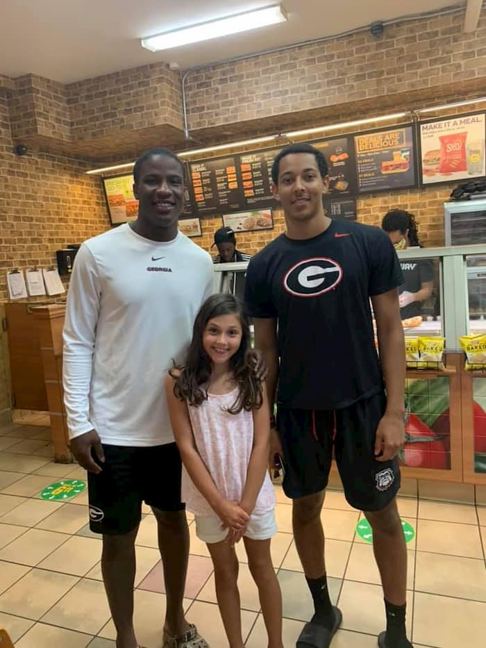 football-player-helps-kid-subway-2