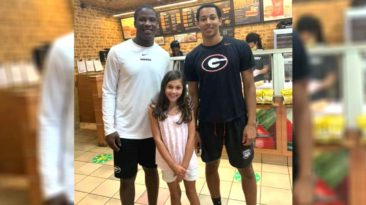 football-player-helps-kid-subway