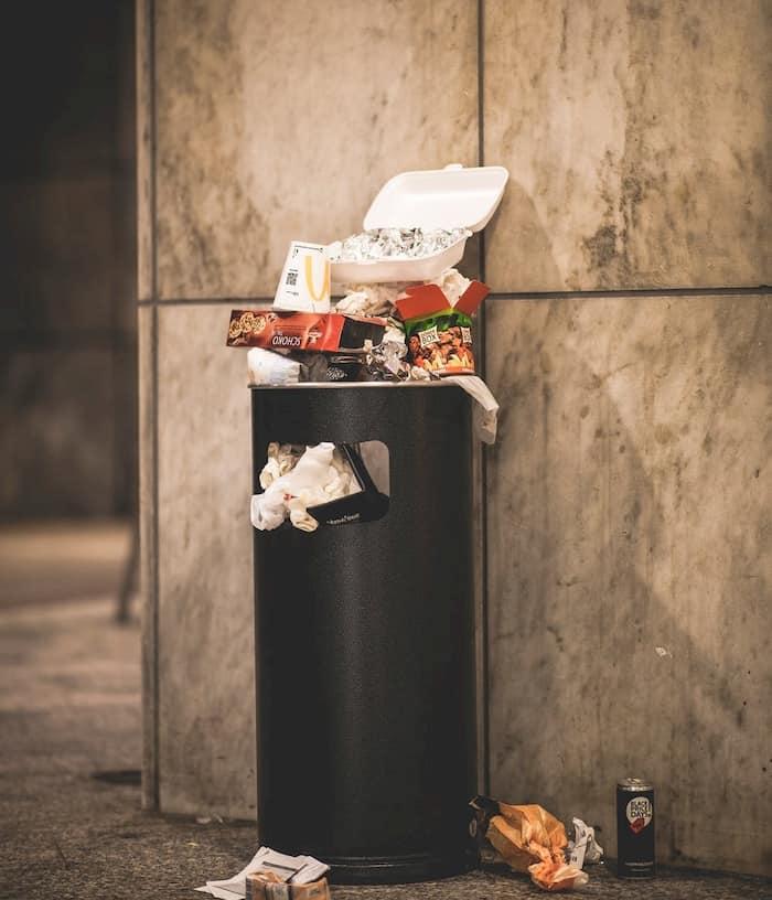 homeless-man-eats-from-trash