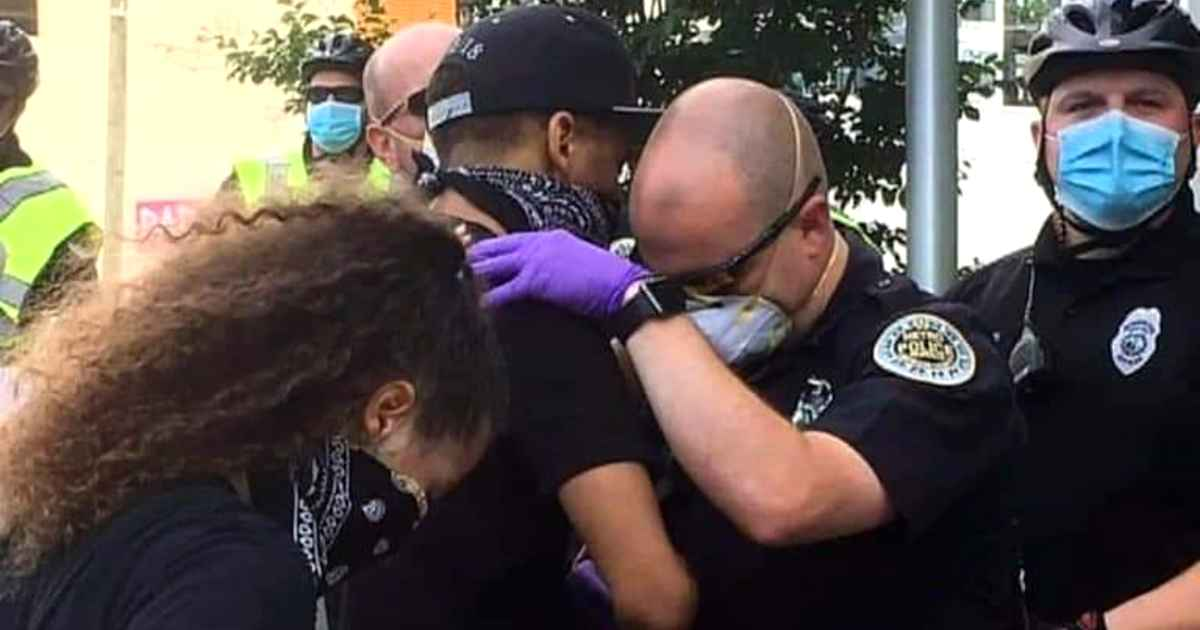 police-officer-prays-with-protester