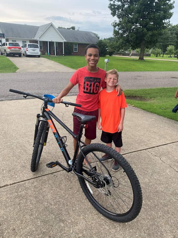 boy-gives-friend-bike-3