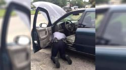 police-officer-helps-fix-car