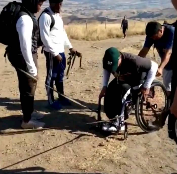 football-team-carries-man-in-wheelchair-to-fremont's-mission-peak-3