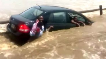 man-saves-family-from-flood-water