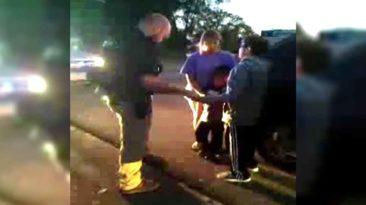 boy-prays-with-police-officer