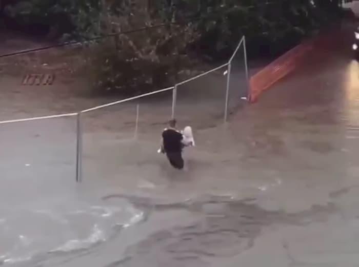 man-carries-grandma-in-flood-waters-2