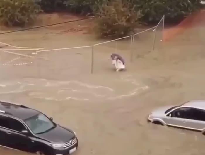 man-carries-grandma-in-flood-waters-4