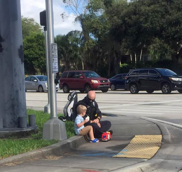 police-officer-comforts-toddler-after-accident-2