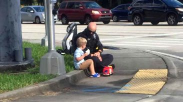 police-officer-comforts-toddler-after-accident