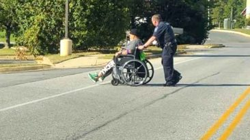 police-officer-helps-man-in-wheelchair