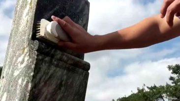 man-cleans-gravestones