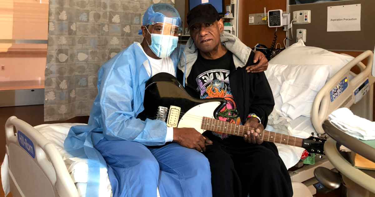 medical-assistant-gives-patient-guitar