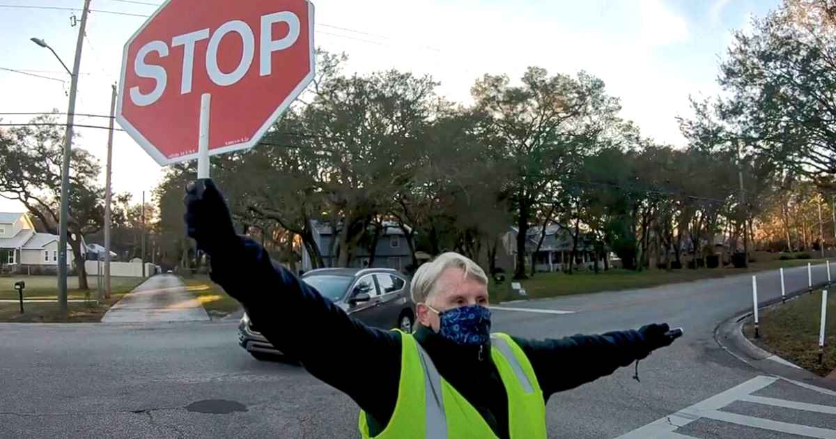 crossing-guard-saves-little-girl