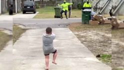 sanitation-worker-dances-with-little-boy