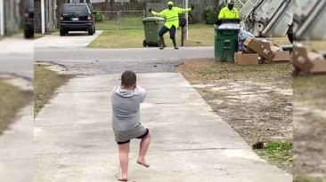 sanitation-worker-dances-with-little-boy