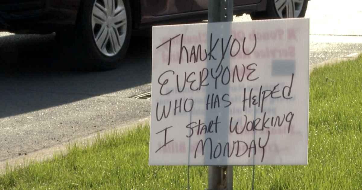 man-thanks-community-sign