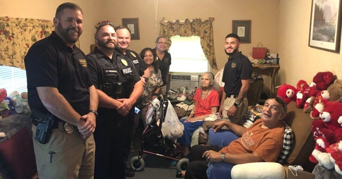police officers help elderly woman