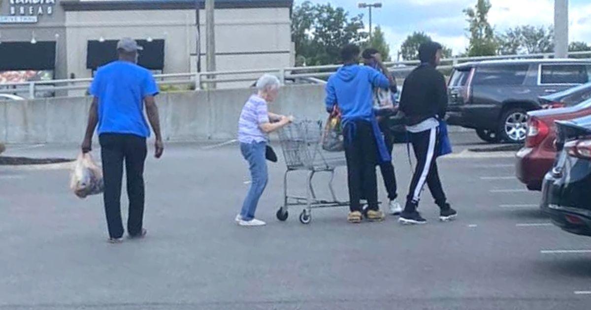 teens help elderly woman