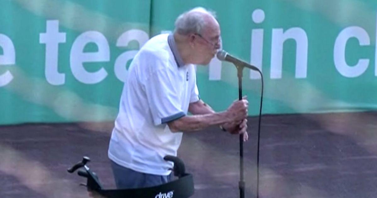 veteran sings national anthem John Pylman