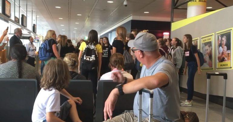 choir singing at airport